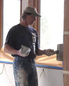 Jeff with Guy Pettit Drywall finishes up the last of the sheetrock mud.