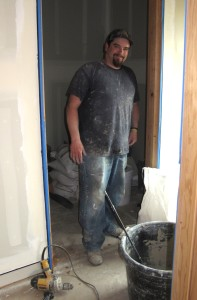 Josh with Green Apple Construction mixes up another batch of American Clay Plaster for application in the main house.