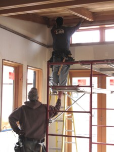 Framers, Scott and Jeremy, installing the reclaimed lumber on the ceiling.