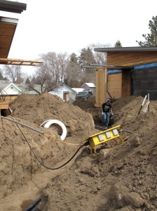 Plumber, Beau Parazoo laying the pipe for graywater and waste water.