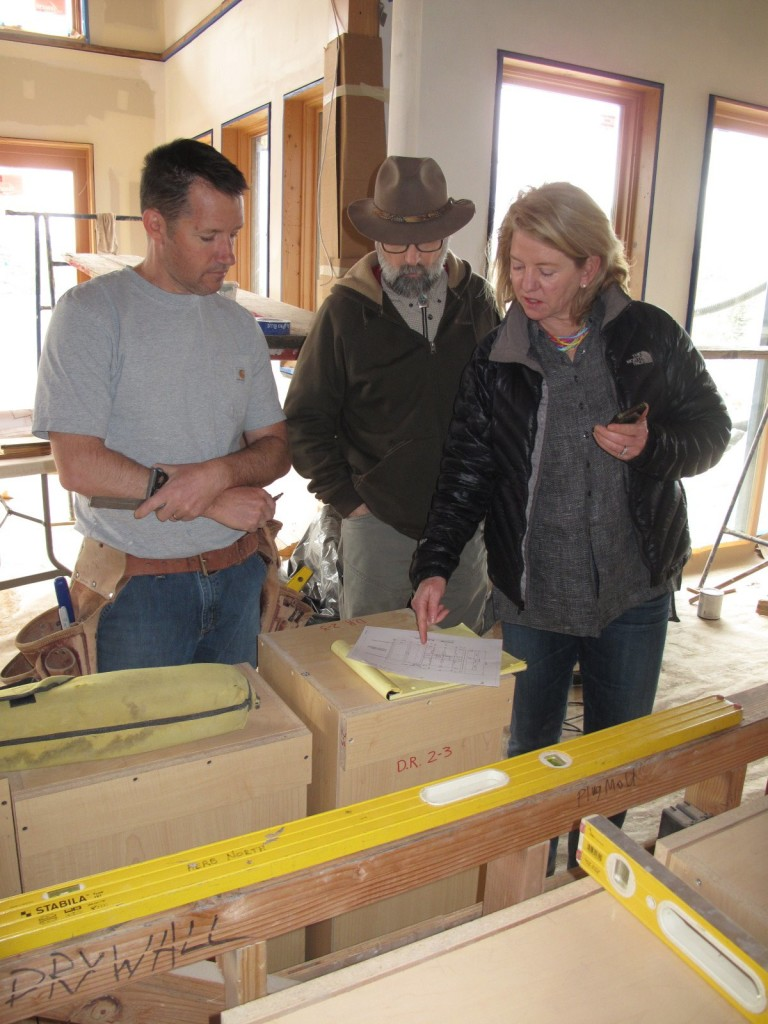 Gabriel Dansky with Dansky Handcrafted, Tom and Barb look at the cabinets.