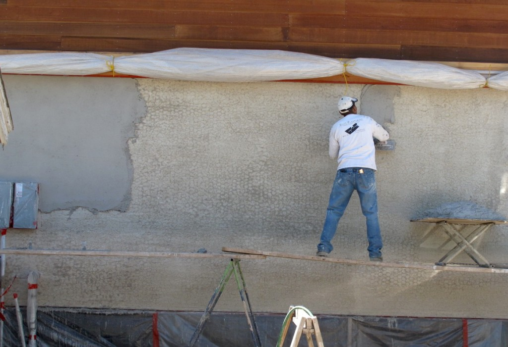 Juan, with Elite Plastering working on the second coat on the garage.