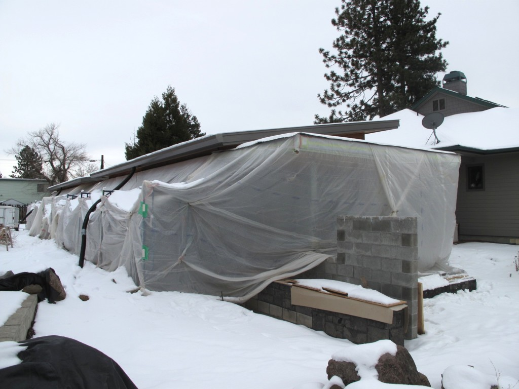 The ADU was wrapped in a plastic tent way back in December, anticipating the beginning of the plastering.