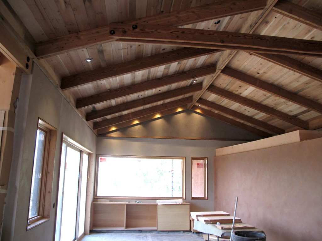 The living space in the main house showing the reclaimed wood ceiling in the glow of the LED lighting.