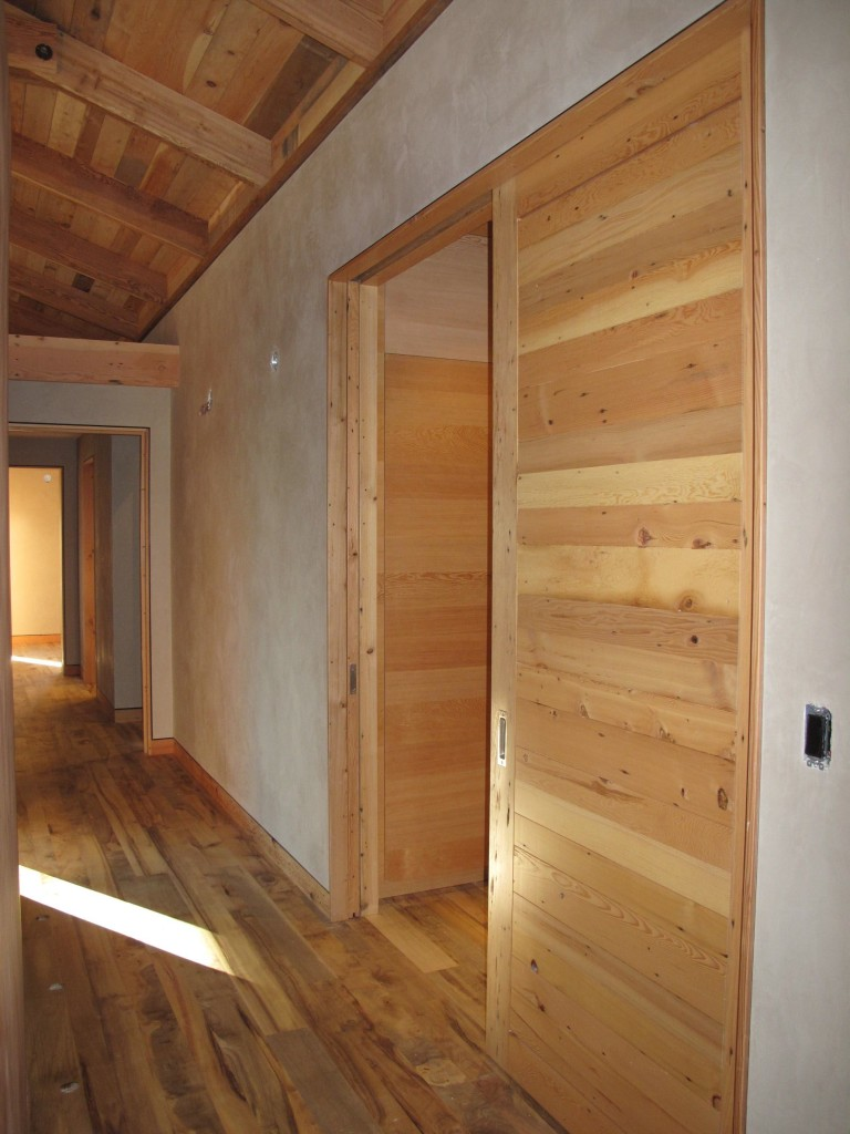 Doors, floors, ceilings, and trim use reclaimed and salvaged wood.